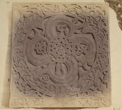 An ayagapata or Jain homage tablet, with small figure of a tirthankara in the centre, from Mathura